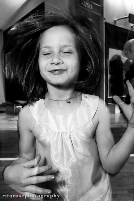 Girl dancing and jumping at a barmitzvah party